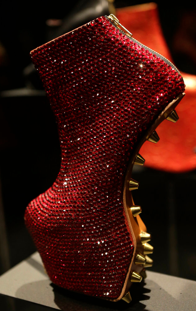 ". An avant-garde, sequined platform heel designed by Noritaka Tatehana displayed at the ""Shoe Obsession\"" exhibit at The Museum at the Fashion Institute of Technology Museum in New York. The exhibition, showing off 153 specimens, runs through April 13. (AP Photo/Kathy Willens)"