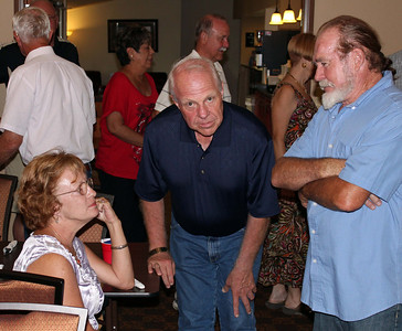 Larry Trout (center) visits with the Amicks.