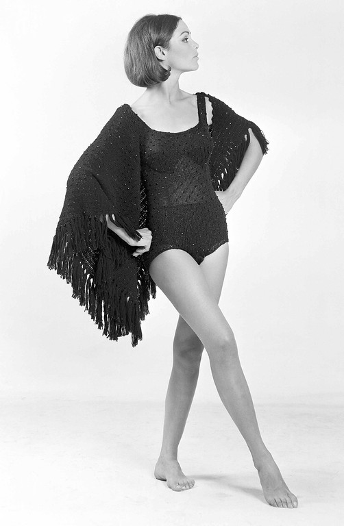. Less startling than a topless swimsuit, but just as unusual, is a handknit black tank suit dotted with jet beads. For cover-up there�s matching fringed shawl, shown in Rome, July 15, 1964 by the Mendola Boutique. (AP Photo/Mario Torrisi)