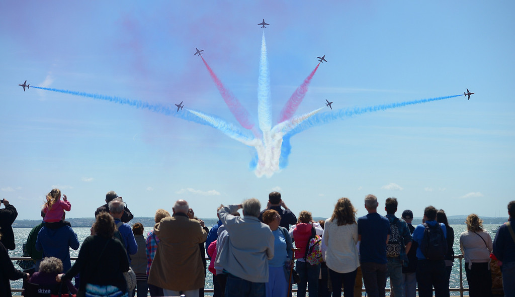 . Britain\'s Red Arrows airplane display team perform during D-Day commemorations in Portsmouth in southern England on June 5, 2014.  AFP PHOTO / CARL COURT/AFP/Getty Images