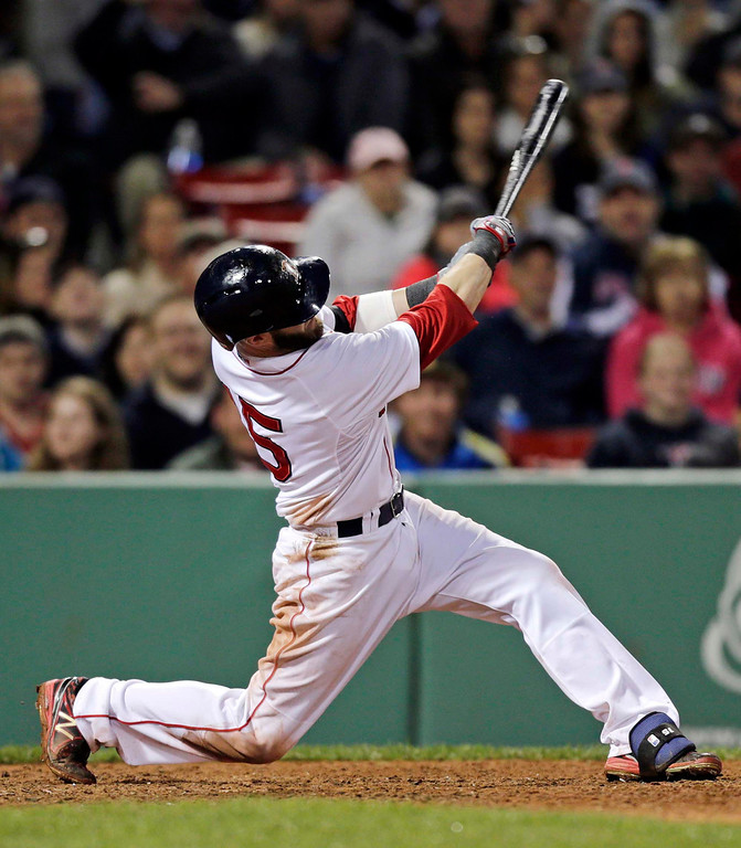 . Boston Red Sox\'s Dustin Pedroia follows through on his solo home run during the eighth inning. (AP Photo/Charles Krupa)