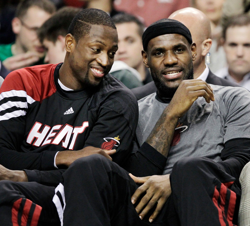 . Miami Heat\'s Dwyane Wade, left, and LeBron James chat on the bench during the first minutes of an NBA basketball game against the Boston Celtics in Boston, Tuesday, April 24, 2012. (AP Photo/Elise Amendola)