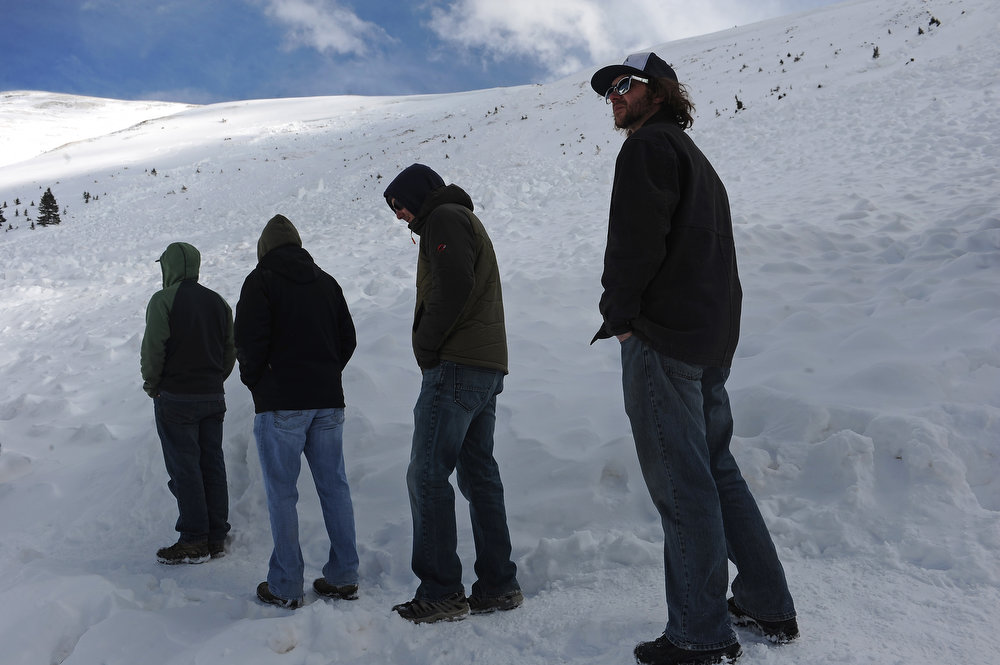 . Friends of 5 avalanche victims visit the site where their friends lost their lives on April 21, 2013.  The large hard slab avalanche happened in an area known as Sheep Creek near Loveland Pass  on the western flank of Mount Sniktau and happened around 2:00 pm on Saturday, April 20, 2013.  One of the victims was buried almost 13 feet deep.  (Photo By Helen H. Richardson/ The Denver Post)