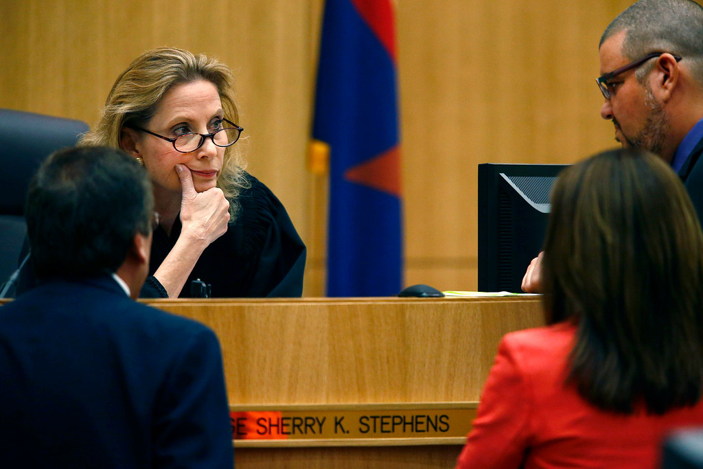 . Judge Sherry Stephens, center, meets with prosecutor Juan Martinez, left, and defense attorneys Jennifer Wilmott and Kirk Nurmi, right,  during closing arguments in Jodi Arias\' murder trial on Friday, May 3, 2013 at Maricopa County Superior Court in Phoenix.  Arias is charged with first-degree murder in the stabbing and shooting death of Travis Alexander, 30, in his suburban Phoenix home in June 2008. (AP Photo/The Arizona Republic, Rob Schumacher, Pool)
