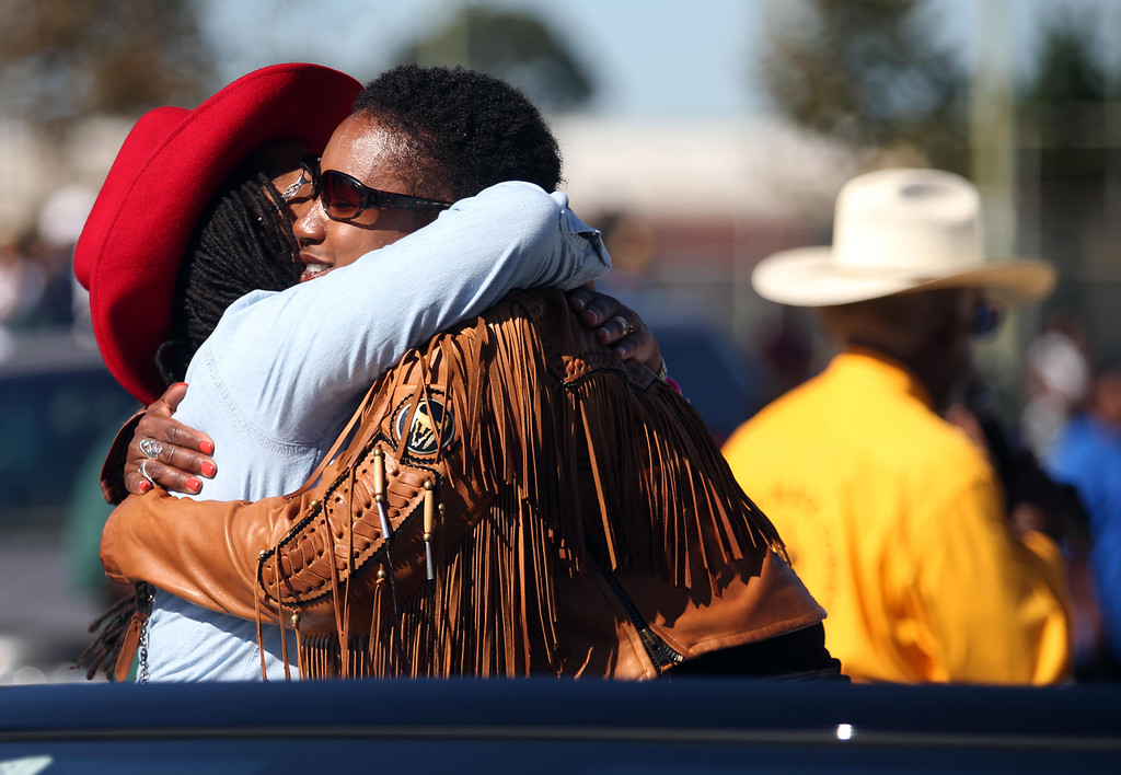 . Oakland City Council District 3 representative Lynette Gibson McElhaney, left, gets a hug from country singer Miko Marks during the 39th annual Oakland Black Cowboy Parade and Heritage Festival in Oakland, Calif., on Saturday, Oct. 5, 2013. The event also featured food, entertainment and pony rides for kids at De Fremery Park. The Oakland Black Cowboy Association began in 1975 and educates the public about the role that black cowboys played in history and building of the west. (Jane Tyska//Bay Area News Group)