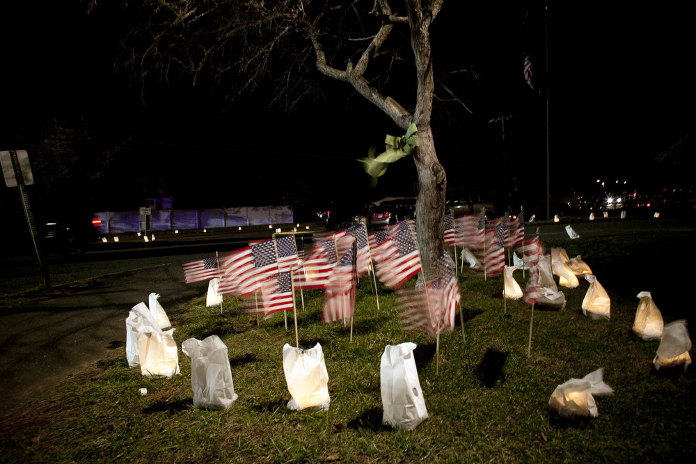 . Bagged candles and American flags are seen in the parking lot of the wake for school principal Dawn Hochsprung, December 19, 2012 in Woodbury, Connecticut. Six victims of the Newtown school shooting are being honored at funerals and visitations across the state today for the victims of Sandy Hook Elementary School. (Photo by Allison Joyce/Getty Images)