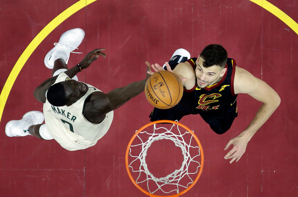 . Cleveland Cavaliers\' Ante Zizic, right, from Croatia, drives to the basket against Milwaukee Bucks\' Thon Maker, from Australia, in the first half of an NBA basketball game, Monday, March 19, 2018, in Cleveland. The Cavaliers won 124-117.(AP Photo/Tony Dejak)