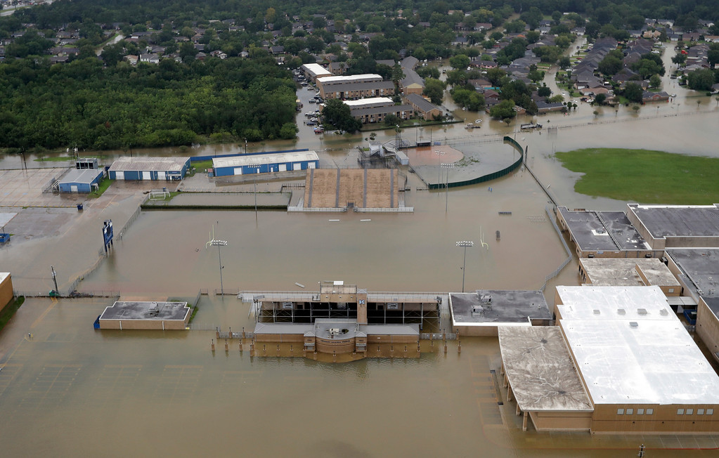 . C.E. King High School\'s football field is covered by floodwaters from Tropical Storm Harvey Tuesday, Aug. 29, 2017, in Houston. (AP Photo/David J. Phillip)