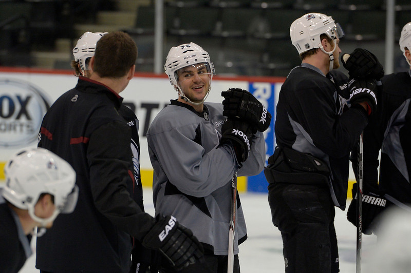 . Colorado Avalanche Joey Hishon (38) smiles while chatting with Adam Foote during practice April 23, 2014 at Xcel Energy Center. (Photo by John Leyba/The Denver Post)