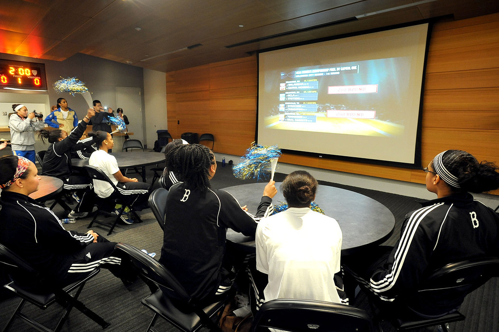 . Members of the UCLA Women\'s basketball team look on as their team receives the 3rd seed in the NCAA tournament during the NCAA Women\'s Basketball Selection Show Monday March 18, 2013 in Westwood, CA.(Andy Holzman/Los Angeles Daily News)
