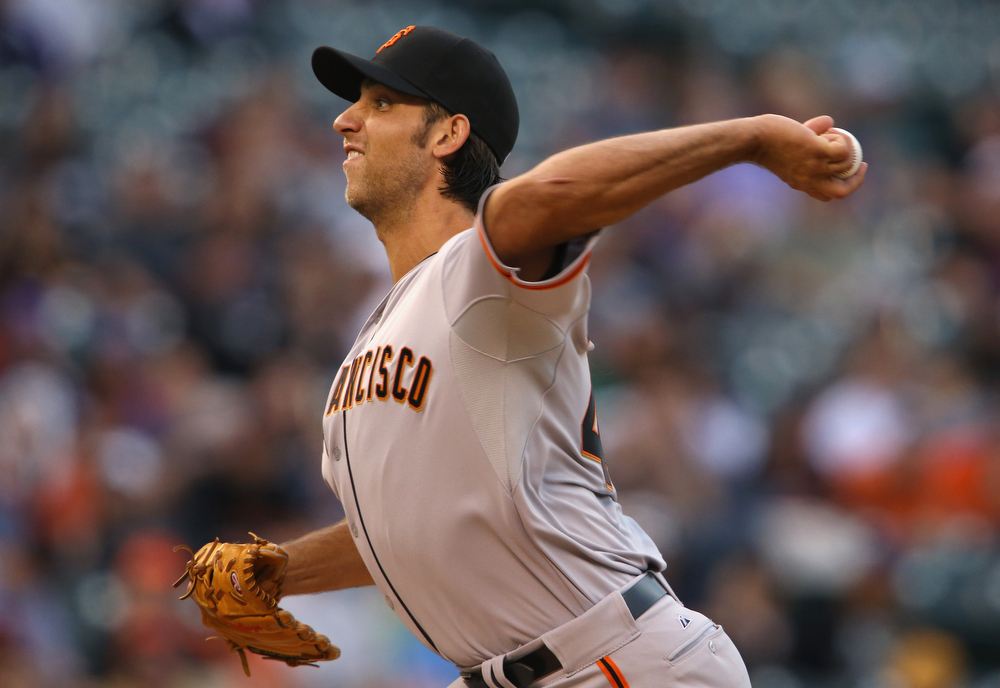 . Starting pitcher Madison Bumgarner #40 of the San Francisco Giants delivers against the Colorado Rockies at Coors Field on April 22, 2014 in Denver, Colorado.  (Photo by Doug Pensinger/Getty Images)