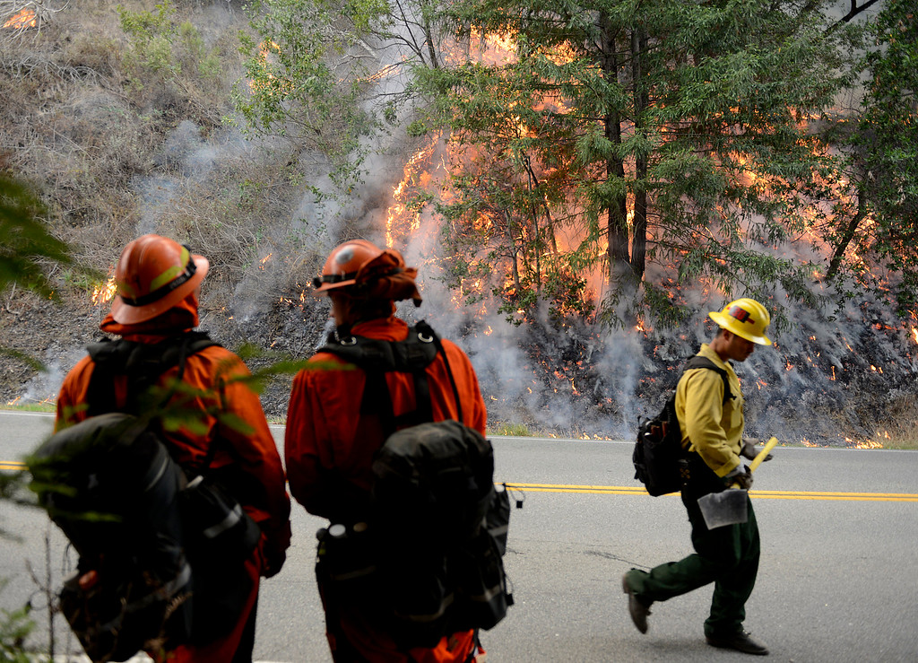 . Firefighters keep an eye on a backfire along Highway 1 between Pfeiffer Ridge Road and the Big Sur Station in Big Sur, Calif. on Wednesday December 18, 2013. (Photo David Royal/ Monterey County Herald)