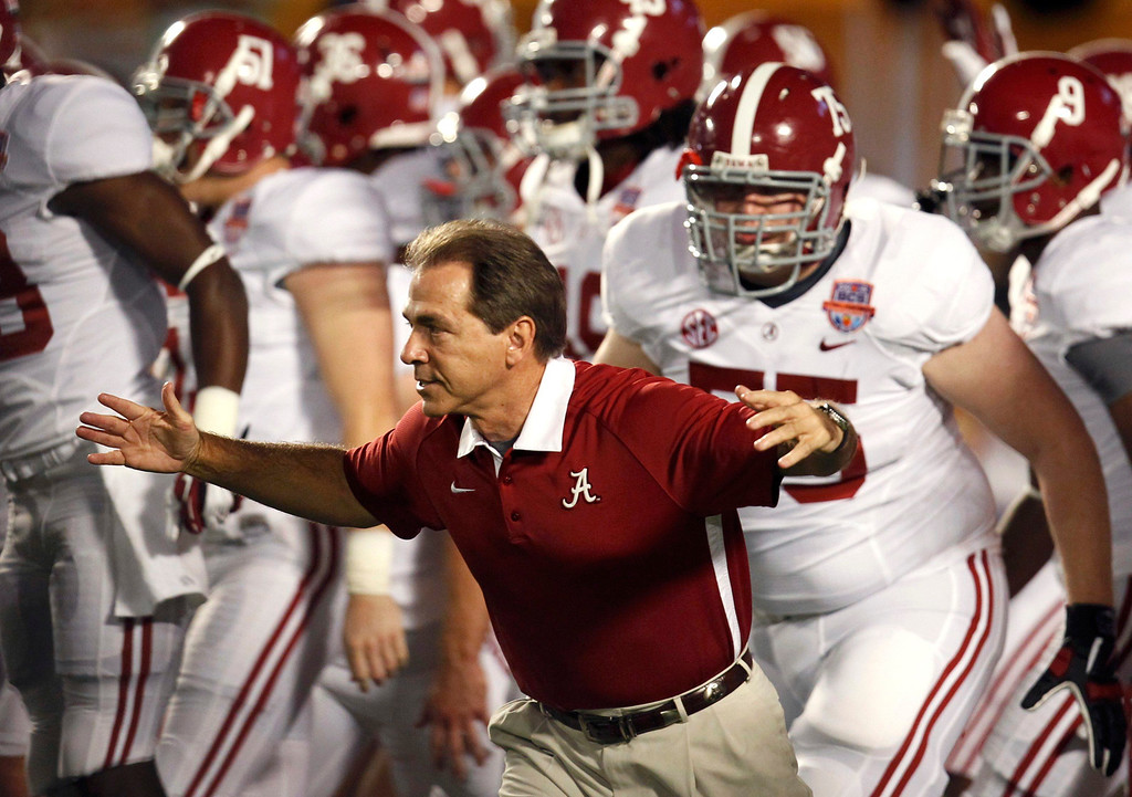 . Alabama Crimson Tide head coach Nick Saban takes the field to face the Notre Dame Fighting Irish in the NCAA BCS National Championship college football game in Miami, Florida, January 7, 2013. REUTERS/Jeff Haynes