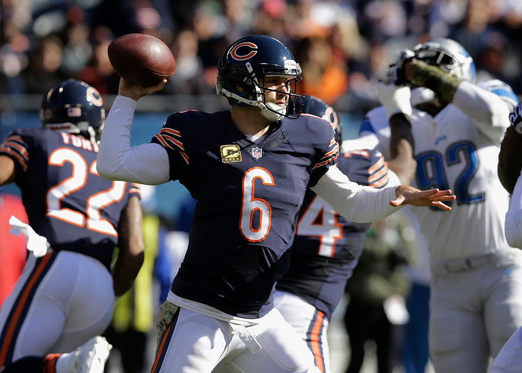 . Chicago Bears quarterback Jay Cutler (6) passes against the Detroit Lions during the first half of an NFL football game, Sunday, Nov. 10, 2013, in Chicago. (AP Photo/Nam Y. Huh)