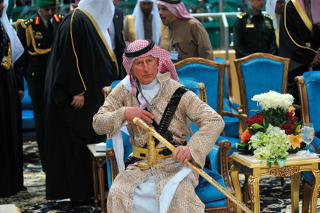 ". Britain\'s Prince Charles wears a traditional Saudi uniform as he attends the traditional Saudi dancing best known as \""Arda,\"" performed during Janadriya culture festival at Der\'iya in Riyadh, Tuesday, Feb. 18, 2014.   (AP Photo/Fayez Nureldine, File Pool)"