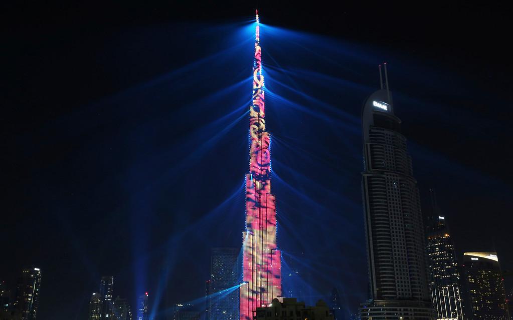 . An LED light show illuminates the Burj Khalifa, the world\'s tallest building, to celebrate the New Year in Dubai, United Arab Emirates, Monday, Jan. 1, 2018. (AP Photo/Jon Gambrell)