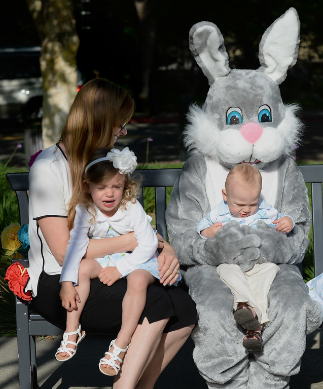 ". While Teddy Sentinella, 1, of Danville, sits on the Easter Bunny\'s lap while is sister Molly Sentinella, 2, is seen to the left with her mother, who did not wish to be identified, during the Town of Danville\'s ""Eggstravaganza\"" held at the Danville Community Center in Danville, Calif., on Saturday, April 12, 2014. The event featured egg hunts for children of all ages as well as fun activities and snacks. (Dan Honda/Bay Area News Group)"