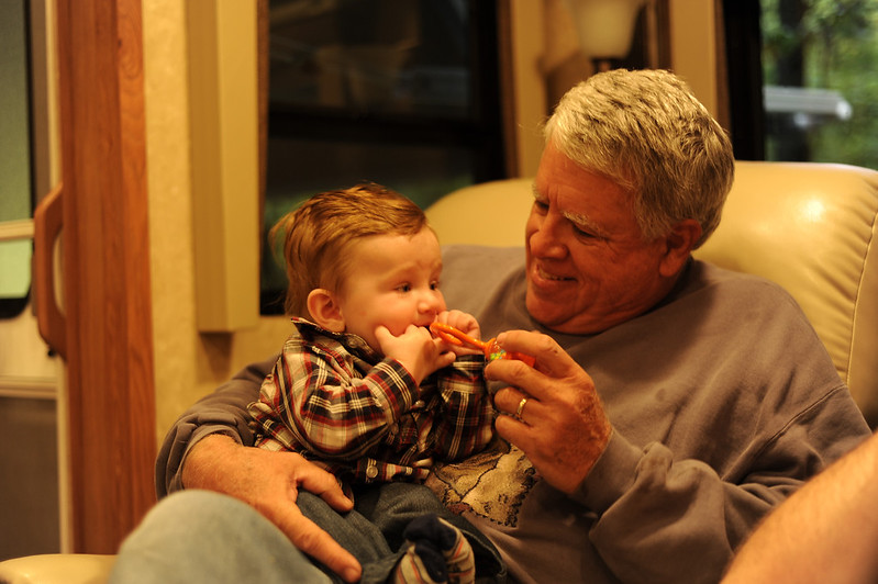 Grandpa Spiegelhalter force-feeding a rattle to Jack