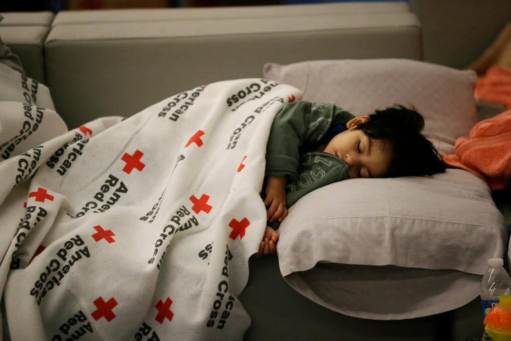 . ADDS NAME OF BOY - Malachia Medrano, 2, sleeps at the George R. Brown Convention Center that has been set up as a shelter for evacuees escaping the floodwaters from Tropical Storm Harvey in Houston, Texas, Tuesday, Aug. 29, 2017. (AP Photo/LM Otero)