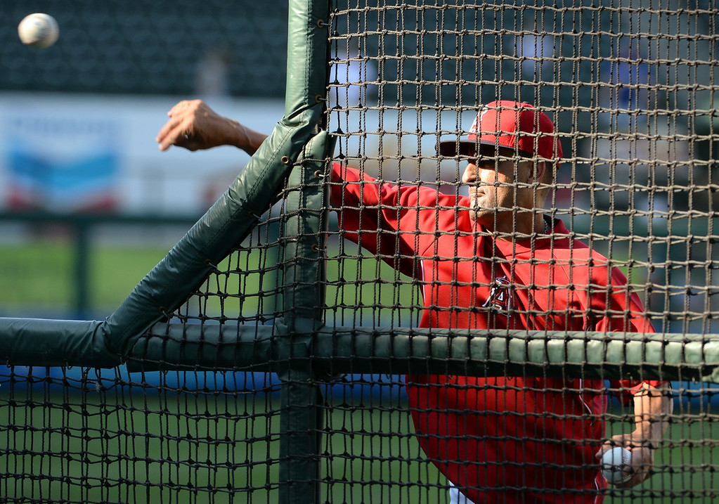 . Los Angeles Angels bench coach Dino Ebel throws batting practice prior to a baseball game against the Los Angeles Dodgers at Anaheim Stadium in Anaheim, Calif., on Thursday, Aug. 7, 2014.  (Photo by Keith Birmingham/ Pasadena Star-News)