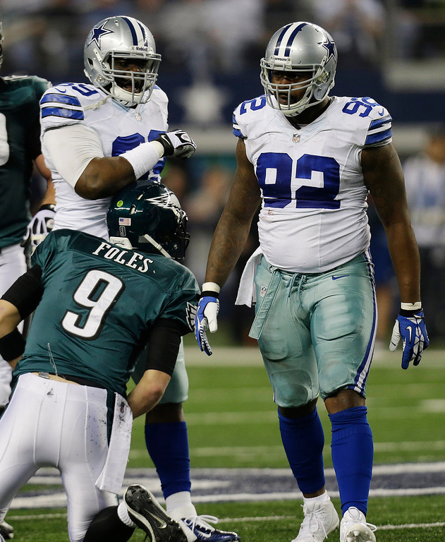 . After sacking Philadelphia Eagles quarterback Nick Foles (9), Dallas Cowboys defensive end Jarius Wynn (92) celebrates with defensive tackle Corvey Irvin (69) during the first half of an NFL football game, Sunday, Dec. 29, 2013, in Arlington, Texas. (AP Photo/Tim Sharp)