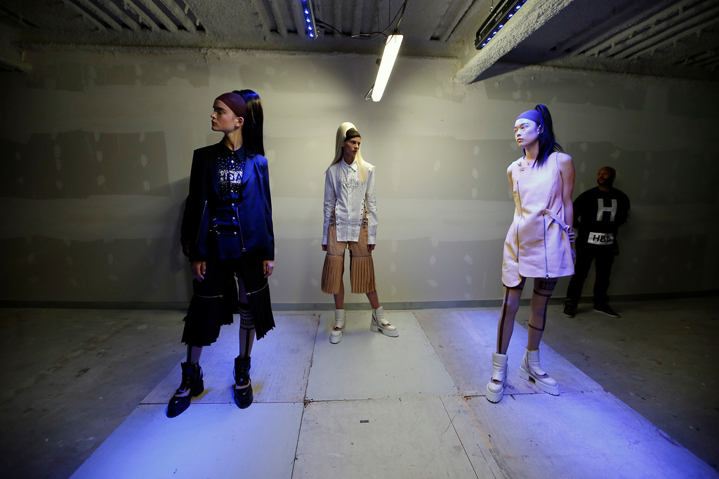 . Models present creations by U.S. fashion designer Shayne Oliver for Hood By Air\'s Spring-Summer 2015 ready-to-wear fashion collection presented in Paris, France, Tuesday, Sept. 23, 2014. (AP Photo/Francois Mori)