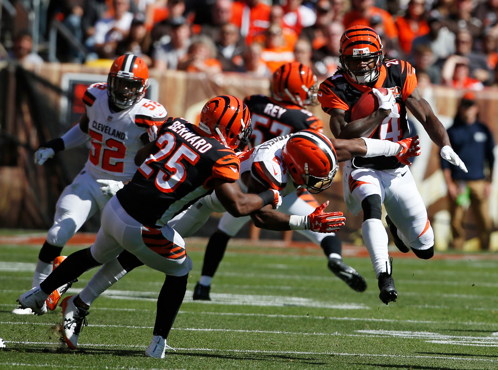 . Cincinnati Bengals cornerback Adam Jones, right, returns a punt in the first half of an NFL football game against the Cleveland Browns, Sunday, Oct. 1, 2017, in Cleveland. (AP Photo/Ron Schwane)