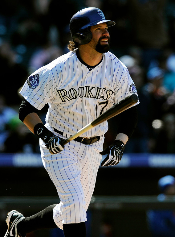 . Colorado Rockies\' Todd Helton follows through on a two-RBI double against the New York Mets during the seventh inning of a baseball game on Thursday, April 18, 2013, in Denver. (AP Photo/Jack Dempsey)