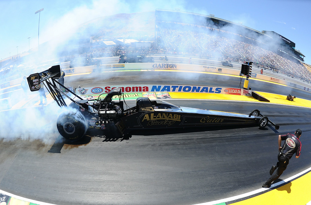 . Eventual Top Fuel winner Khalid alBalooshi does his burnout during the quarterfinals Sunday July 27, 2014 at the 27th annual NHRA Sonoma Nationals. alBalooshi defeated his teammate Shawn Langdon (from Mira Loma) in the finals. Khalid alBalooshi (Top Fuel), Courtney Force (Funny Car), Jason Line (Pro Stock) and Eddie Krawiec (Pro Stock Motorcycle) all won event titles in their respective classes Sunday July 27, 2014 at the 27th annual NHRA Sonoma Nationals. (Will Lester/Staff Photographer)