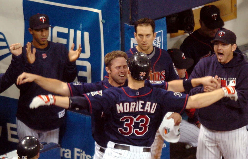 . Minnesota\'s Michael Cuddyer congratulates Justin Morneau after his solo home run during the sixth inning of Game 2 of the American League Divisional Series in Minneapolis on Wednesday, October 4, 2006. (Sherri LaRose-Chiglo, Pioneer Press)
