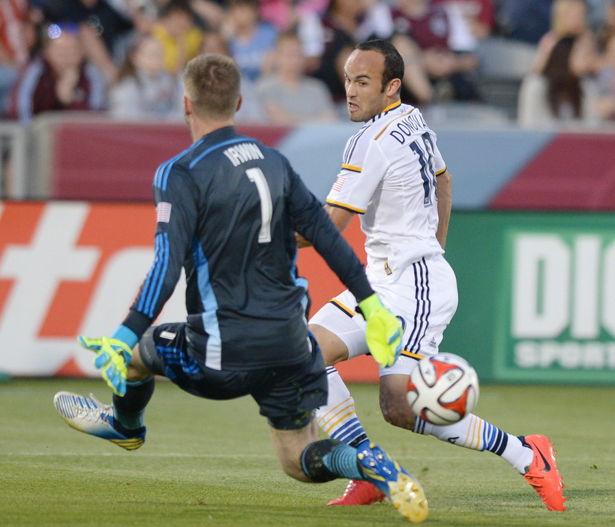 . COMMERCE CITY, CO - MAY 3:  Galaxy midfielder Landon Donovan tried to sneak a shot past an advancing Colorado goalie Clint Irwin in the first half. The Colorado Rapids hosted the Los Angeles Galaxy Saturday night, May 3, 2014 at Dick\'s Sporting Good Park. (Photo by Karl Gehring/The Denver Post)