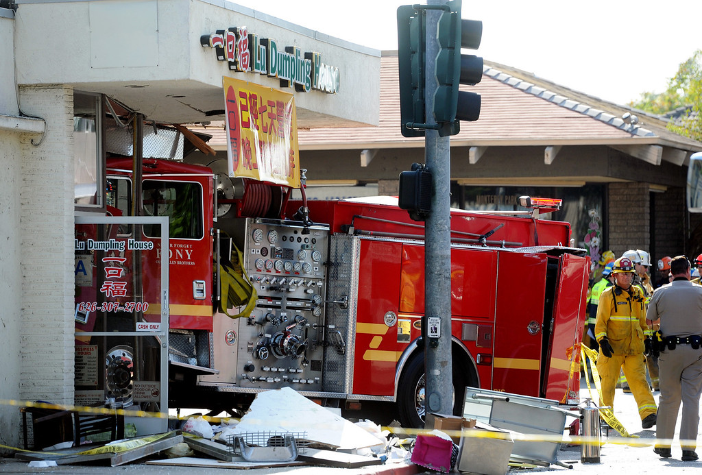 . Emergency personnel investigate the scene where a fire truck that crashed into Lu Dumpling House restaurant after it collided with another fire engine at the intersection of Emerson Avenue and Garfield Avenue in Monterey Park on Wednesday, April 16, 2014. (Photo by Walt Mancini/ Pasadena Star-News)