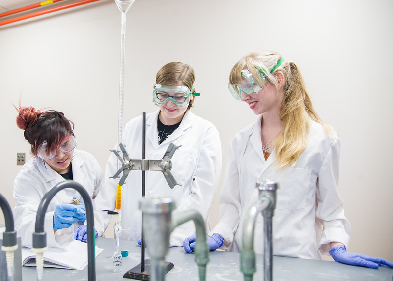 Student Loren M Gonzales (left), Savannah Boorowman and Zoey Seal working together to filter out Bromine in their Organic Chemisty class.