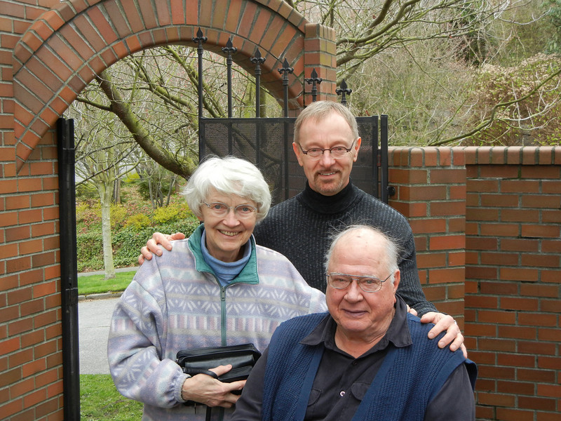 Mom, Bill and Dad on the deck outside the back door of Bill's Seattle house