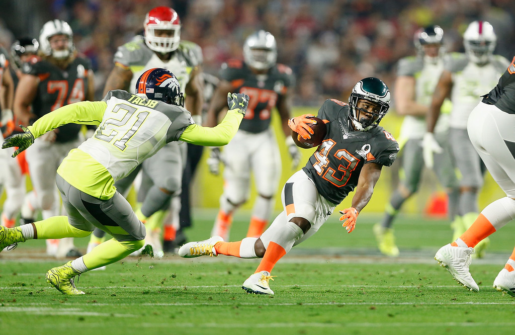 . GLENDALE, AZ - JANUARY 25: Team Irvin return specialist Darren Sproles #43 of the Philadelphia Eagles runs by Team Carter cornerback Aqib Talib #21 of the Denver Broncos during the second half of the 2015 Pro Bowl at University of Phoenix Stadium on January 25, 2015 in Glendale, Arizona.  (Photo by Christian Petersen/Getty Images)