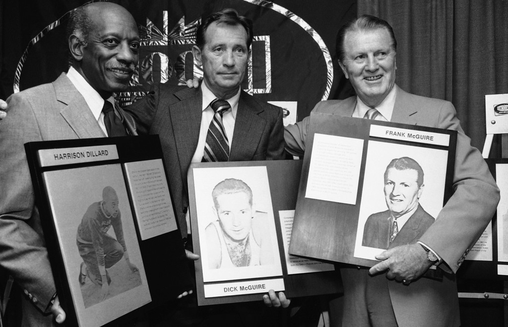 . Olympic track star Harrison Dillard, left, New York Knicks basketball star Dick McGuire, center, and Frank McGuire, who won 100 games at different colleges, were among 10 sports celebrities inducted into the Madison Square Garden Hall of Fame in New York on Wednesday, June 3, 1982. (AP Photo/Marty Lederhandler)