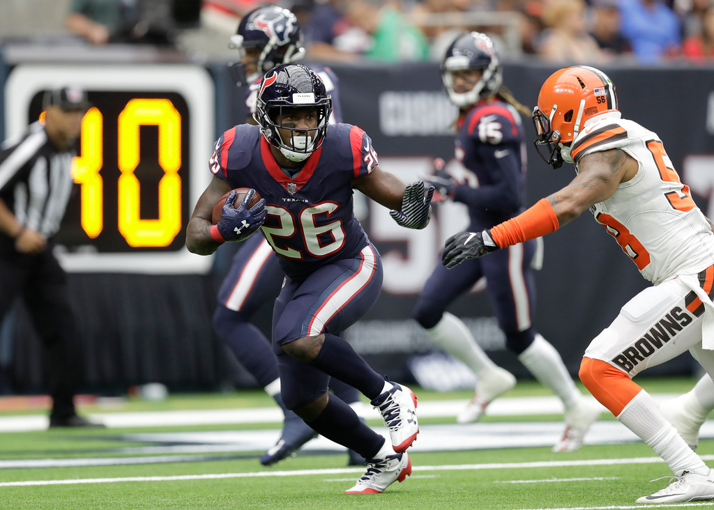 . Houston Texans running back Lamar Miller (26) runs the ball fighting off a tackle by Cleveland Browns linebacker Christian Kirksey (58) in the first half of an NFL football game, Sunday, Oct. 15, 2017, in Houston. (AP Photo/Eric Gay)