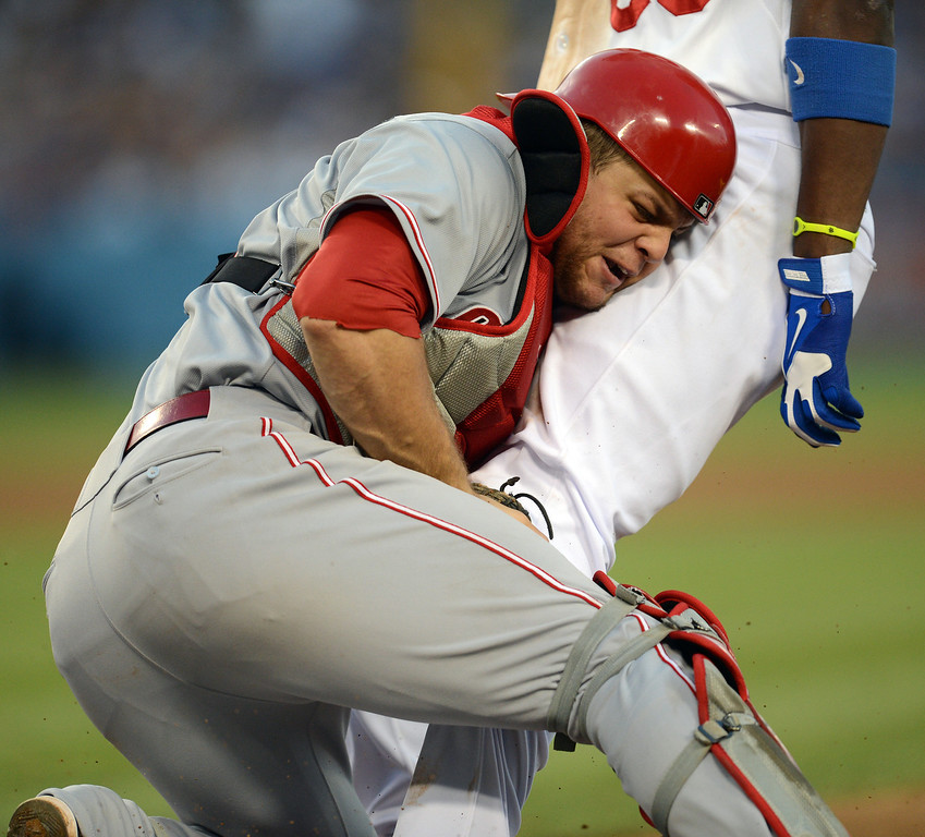. The Reds\' catcher Devin Mesoraco #39 tags out the Dodgers\' Yasiel Puig #66 at 1st base in the 5th inning during their game at Dodger Stadium in Los Angeles Saturday, July 27, 2013. (Hans Gutknecht/Los Angeles Daily News)