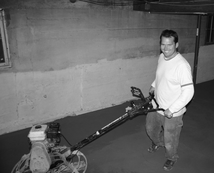 """Eddy smoothing the basement floor after 6"""" of concrete was poured."""
