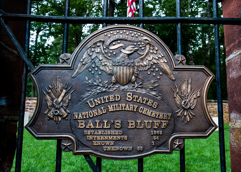 Plaque located on entrance gate of National Military Cemetery, Ball's Bluff Battlefield, VA. The cemetery contains 54 internments but only 26 grave markers. Fifty three soldiers are unknown.