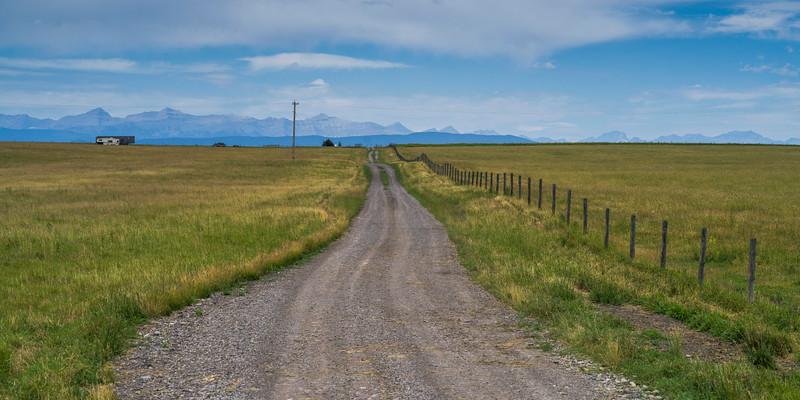 Dirt road passing through landscape, Longview, Cowboy Trail, Southern Alberta, Alberta, Canada