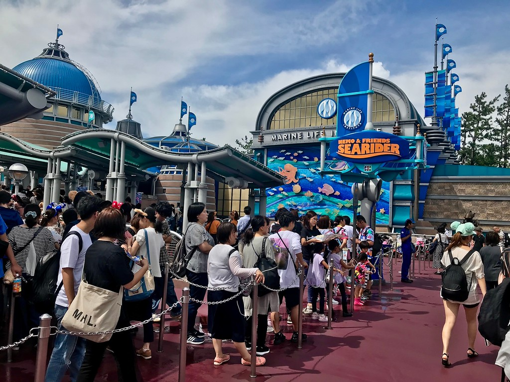 Long queues for the Nemo & Friends Searider attraction.