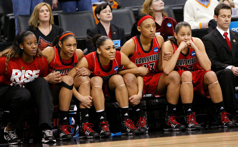 . Louisville\'s bench watches as Monique Reid, not shown, shoots the winning free throws against Baylor during the second half of a regional semifinal in the women\'s NCAA college basketball tournament in Oklahoma City, Sunday, March 31, 2013. Louisville won 82-81. (AP Photo/Alonzo Adams)