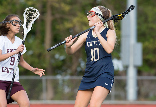 05/10/19 Wesley Bunnell | Staff Newington girls lacrosse defeated Bristol Central in an away game at Bristol Central High School on Friday afternoon. Maykayla Bunker (9) Newington's Hannah Drew (10).