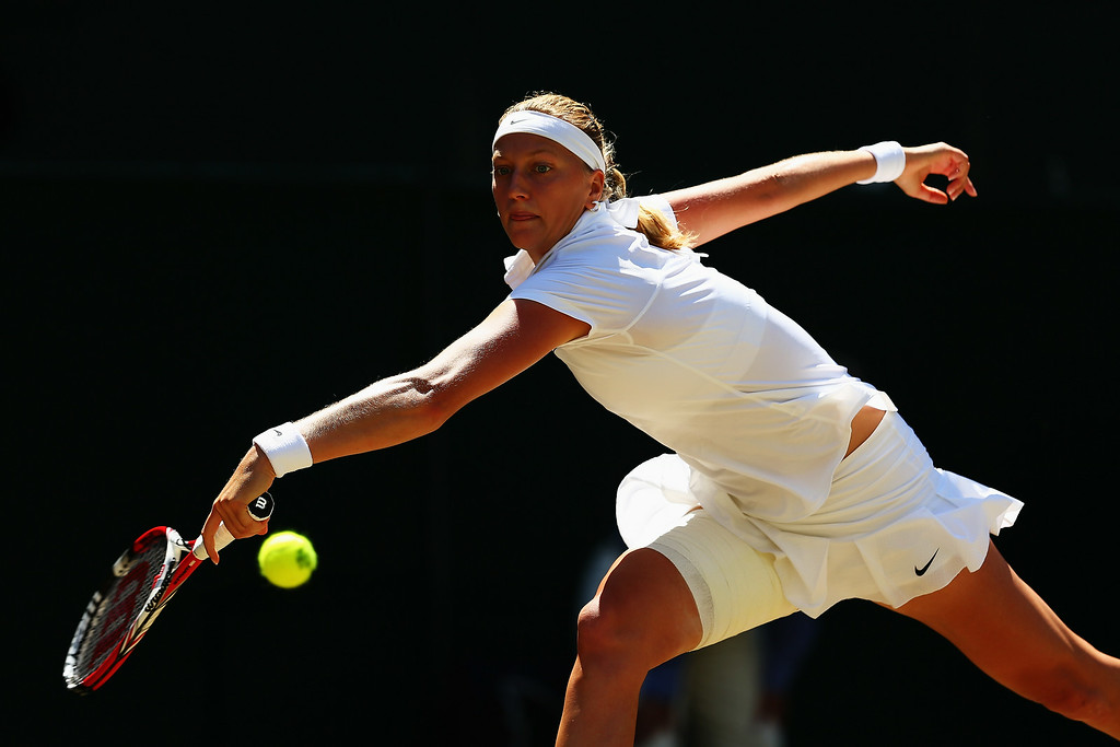 . Petra Kvitova of Czech Republic stretches to make a return during her Ladies\' Singles semi-final match against Lucie Safarova of Czech Republic on day ten of the Wimbledon Lawn Tennis Championships at the All England Lawn Tennis and Croquet Club  on July 3, 2014 in London, England.  (Photo by Clive Brunskill/Getty Images)