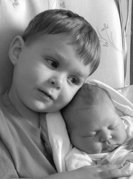 Baby's first day, first day as a big brother, taken indoors at Durham Regional Hospital, Durham, NC using only natural light.