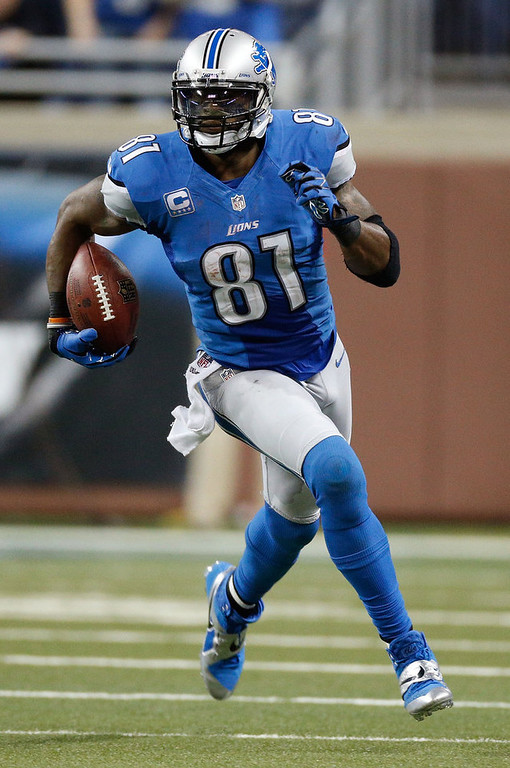 . Calvin Johnson #81 of the Detroit Lions runs for 26 yards after a fourth quarter catch while playing the Atlanta Falcons at Ford Field on December 22, 2012 in Detroit, Michigan.  Johnson broke the NFL single season yardage record formally held by Jerry Rice during this play. (Photo by Gregory Shamus/Getty Images)
