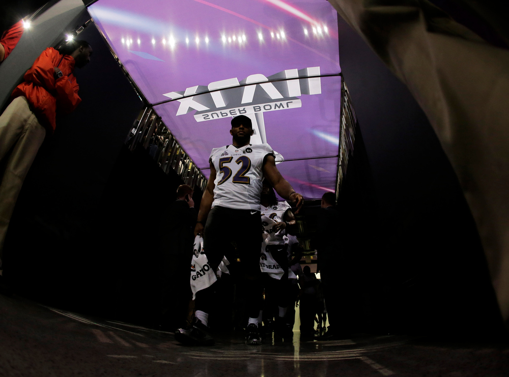 Description of . Baltimore Ravens linebacker Ray Lewis (52) makes his way to a podium during media day for the NFL Super Bowl XLVII football game Tuesday, Jan. 29, 2013, in New Orleans. (AP Photo/Charlie Riedel)