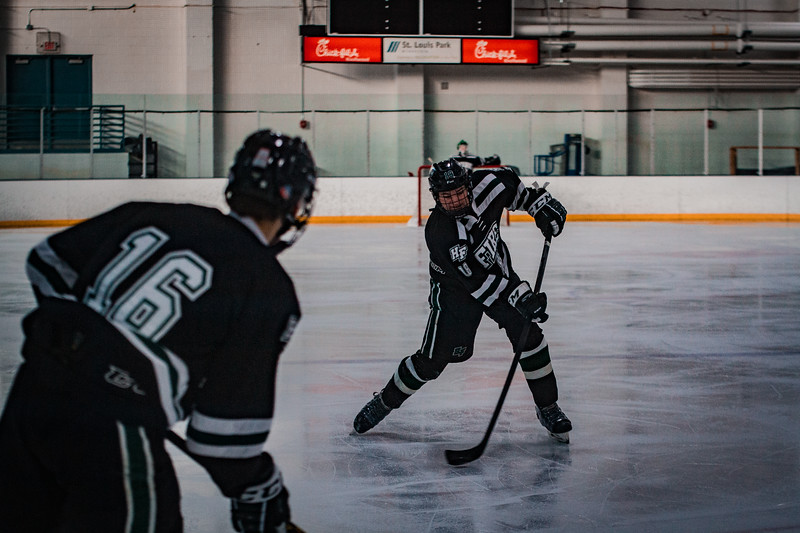 Holy Family Boys Varsity Hockey vs. Elk River, 12/27/19: Spencer Lewin '21 (18)