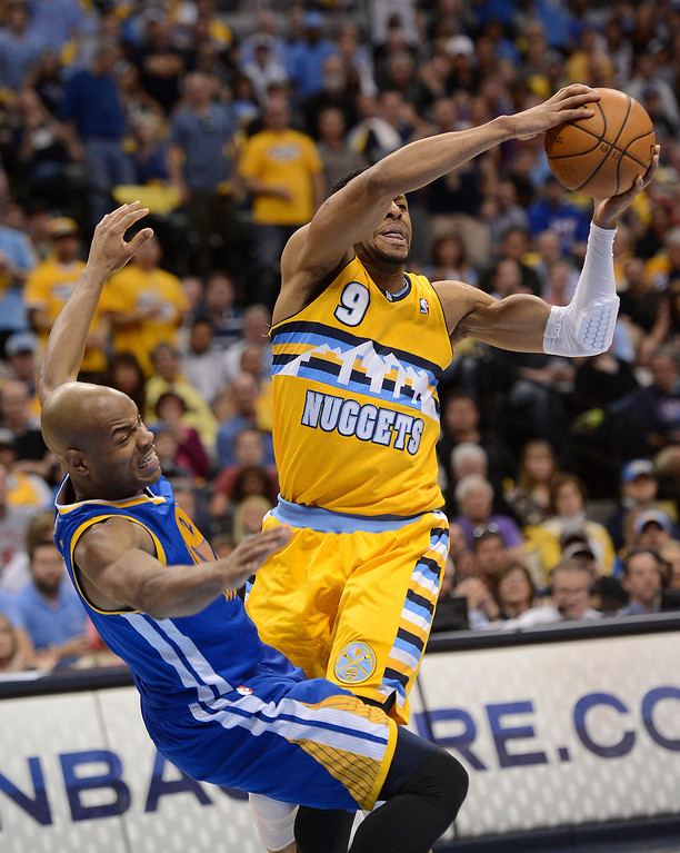 . DENVER, CO. - APRIL 20: Denver Nuggets shooting guard Andre Iguodala (9) collides with Golden State Warriors point guard Jarrett Jack (2) in the second quarter. The Denver Nuggets took on the Golden State Warriors in Game 1 of the Western Conference First Round Series at the Pepsi Center in Denver, Colo. on April 20, 2013. (Photo by John Leyba/The Denver Post)